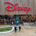 Shoppers are walking into the Disney store in Shanghai