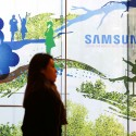 Samsung Electronics chief apologizes for scandal, rejects calls for company reform